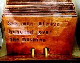 "From The Watcher Files: ""She had her own reason for participating,"" a poem stamped on 3x5 copper cards."