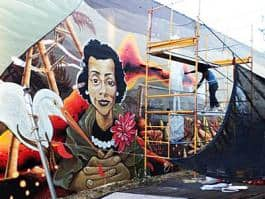 Artists Eatcho and Jeremy Nichols working on a mural for the Black United Fund, 2828 NE Alberta Street. (Photo: William Rihel)