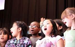 Students at James John Elementary in St. Johns perform an original song they wrote during a Right Brain residency. (Photo by Allie Maya)