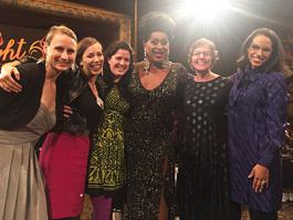 Right Brain staff pose with emcee Poison Waters at the Light a Fire awards dinner on October 20, 2015.