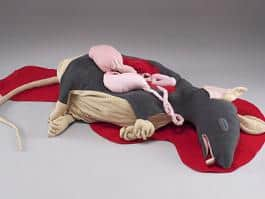 Molly Eno's Dead Rat sculpture from 2013; she and woodworker Joshua Pew are collaborating on a new project at the Portland Building.