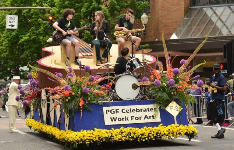 "The PGE Float celebrating Work for Art during the Grand Floral Parade on June 11, 2016. The float claimed the Rose Festival Court Award for ""best example of enthusiasm and teamwork."" (Photo by Vern Uyetake)"