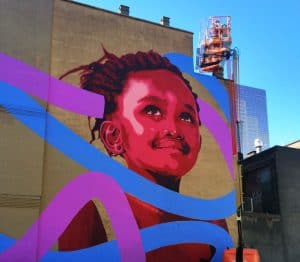 Kevin Ledo's mural in progress as part of