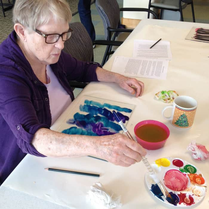 Linda Jackson is a participant in The Giving Tree NW's Art Exploration painting and printing class.
