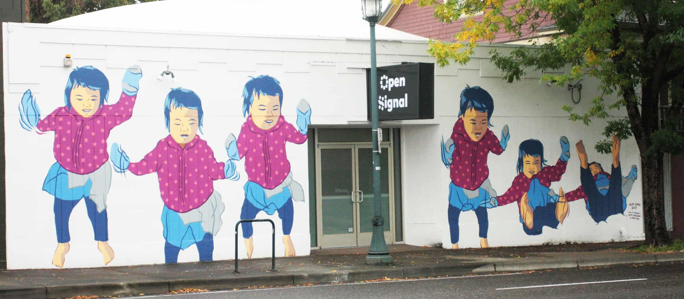 Alex Chiu's mural featuring 6 frames of his daughter jumping up and down a bed