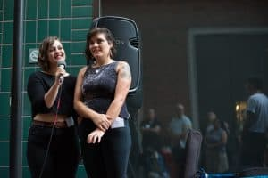Daniela del Mar and Camila Araya of Letra Chueca Press standing and speaking to Latinidades attendees