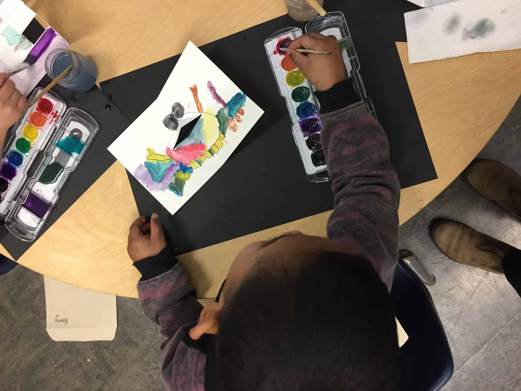A Portland elementary school student digs into their watercolor.