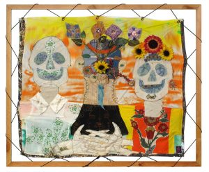 Colorful textile art with day of the dead imagery.