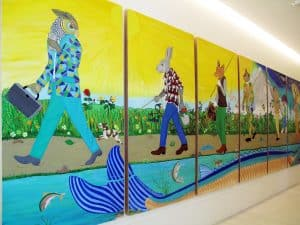 Large panels depict a group of animals dressed as people.